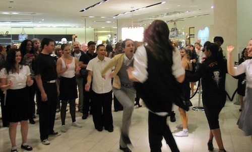 Zac Posen dancing at Saks Fifth Avenue for Fashion's Night Out