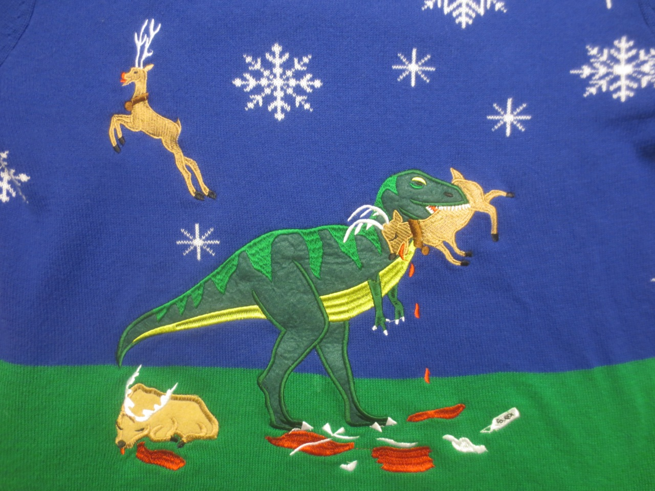 T-rex christmas sweater detail