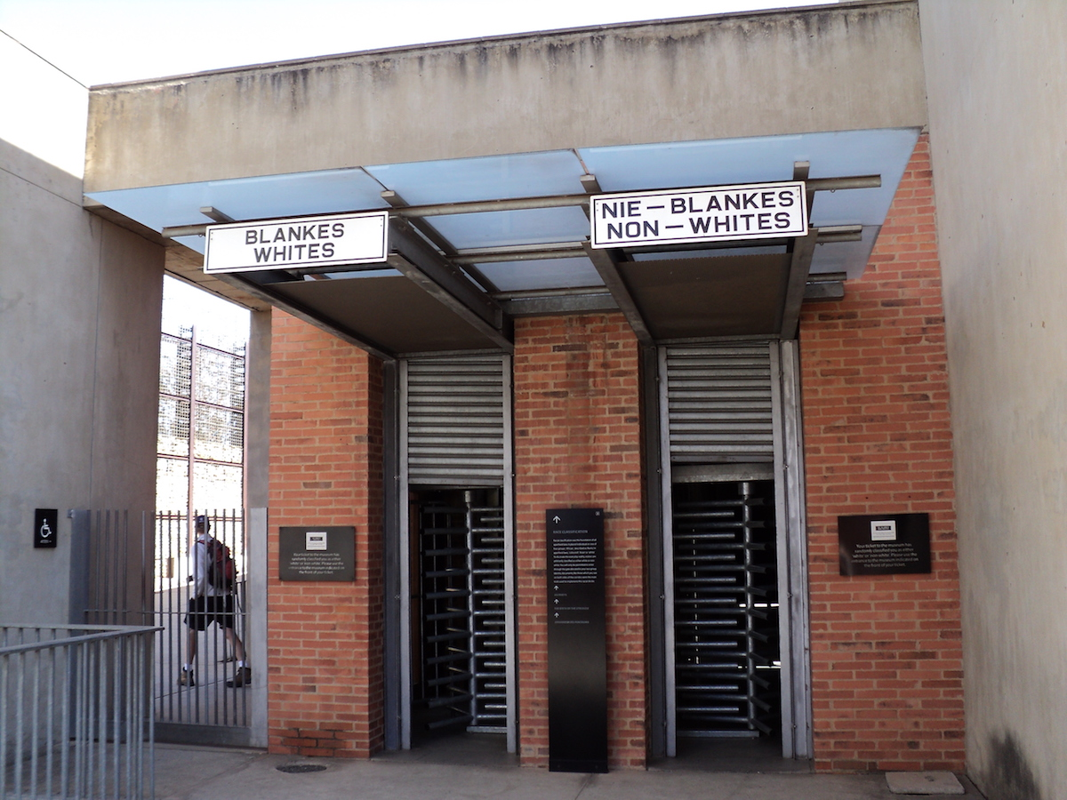 Entrances-for-whites-and-non-whites-to-the-apartheid-museum